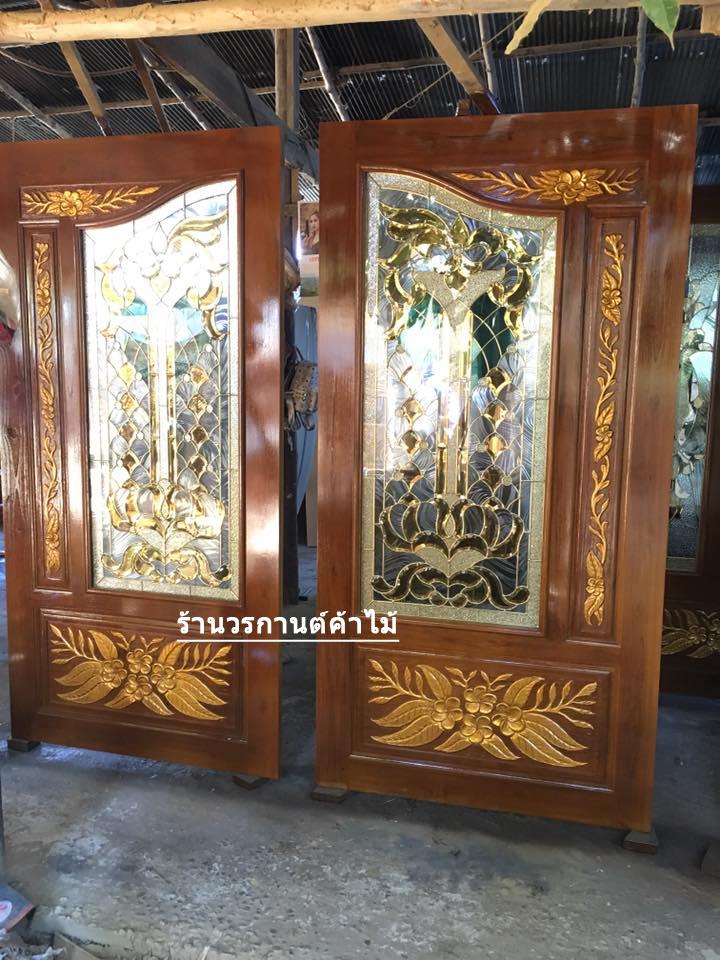 ประตูไม้สักกระจกนิรภัยปีกนก แกะดอกไม้ เกรดA รหัส A03
