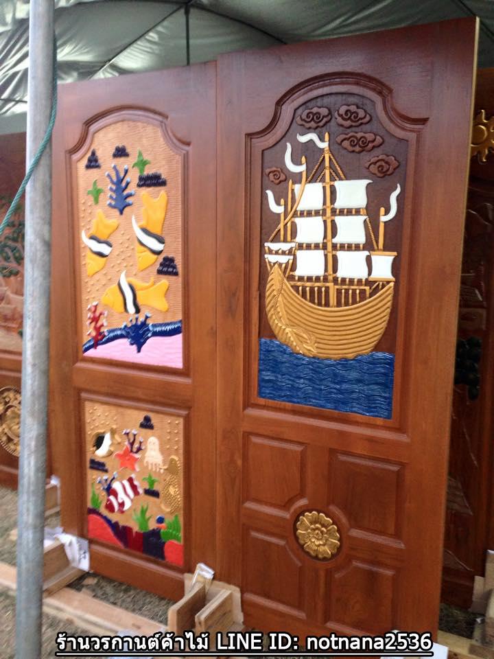 ประตูไม้สักบานเดี่ยว แกะเรือปลา เกรดA, B+ รหัส C65